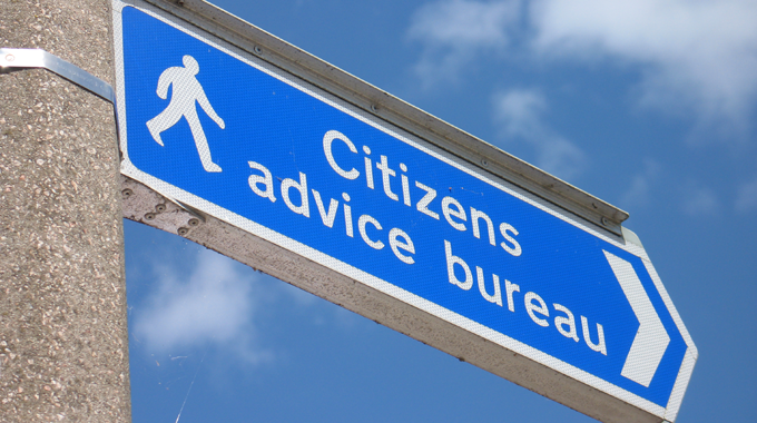 picture of a road sign pointing to citizens advice outlet